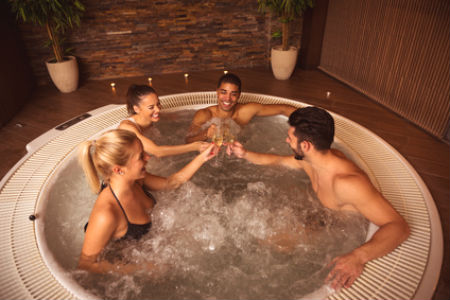 Group having fun in a hot tub